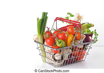 Raw vegetables in basket isolated