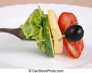 Raw vegetables on fork