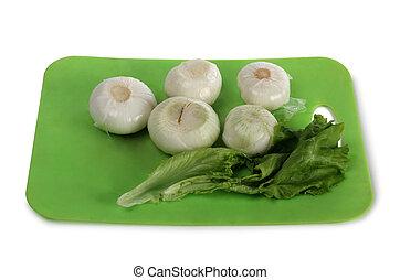 Raw vegetables on white nine