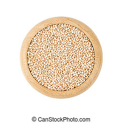 Raw white quinoa seeds in wooden dish.