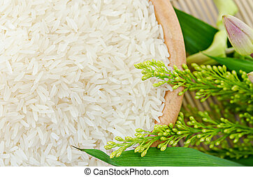 raw white rice in a bowl - top view