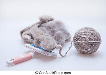 Raw wool yarn coiled into a ball - Persian cat raw wool yarn...