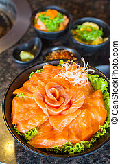 Raws salmon fillet on dish with wasabi in restaurant, Japanese food style