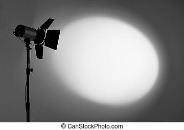Ray of scenic spot light over dark background, stage illumination equipment