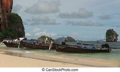boatmen sit in boats - RAYLEY, KRABI/THAILAND - MAY 15 2014...