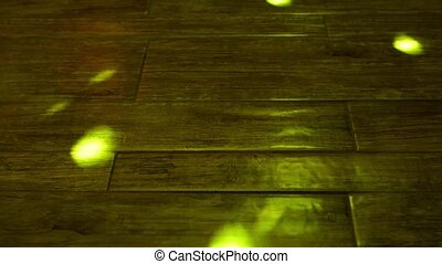 Rays from disco ball on wooden floor