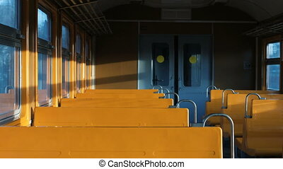rays of light shimmer in an empty car with yellow seats