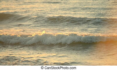 Rays of setting or rising sun sea waves on shore close up. Concept rest relax summer recreation vacation holiday. Natural sea marine oceanic background backdrop. Sunset sunrise dawning at sea ocean