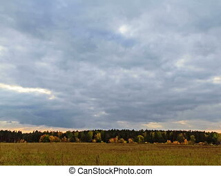 Rays of sun on a background autumn landscape. Time Lapse....