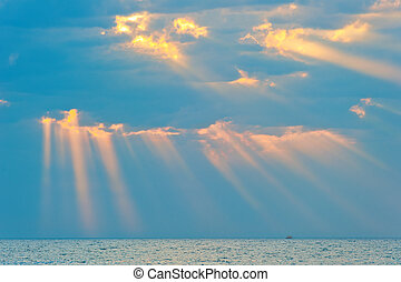 rays of the sun breaking through the clouds over the sea