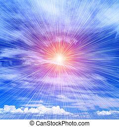 Rays of the sun on the blue sky