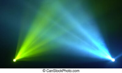 Rays of yellow blue blinking on a black background