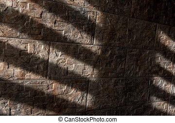 rays on the wall of stone