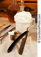 Razor blade and shaving cream in a victorian barbershop