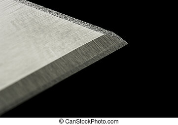 Razor blade macro over black with shallow DOF