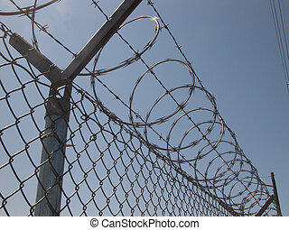 Razor Wire - Caution: Keep Out! This razor wire provides a...