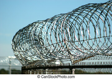 Razor Wire - Razor wire atop security fence at military base