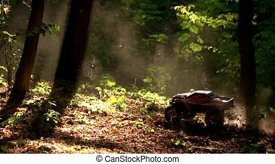 RC monster car in a forest offroad race. Radio controlled ...