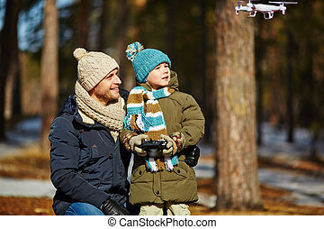 RC toy plane - Father and son observing toy plane