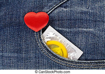 Rea heart and yellow condom in blue jeans pocket