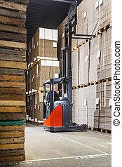 Reach truck in a warehouse