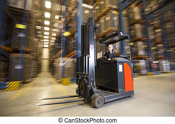 Reach Truck - Panning shot of a reach truck forklift driving...