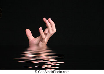 Reaching for help - A hand reaches from dark water for help