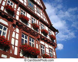 German buildings are created and cared for with pride. Lovingly planted flowers liven this building up.