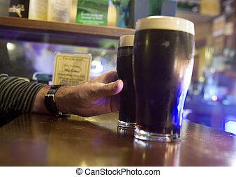 Reaching out for a stout - Male hand reaching for a big...