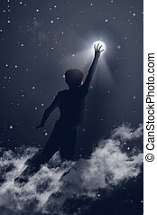 Reaching the moon - Image of little boy reaching the moon in...