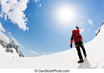 Reaching the summit - A male mountaineer expresses his joy...