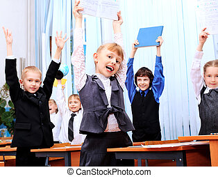 reaction - Happy children in a class at school.