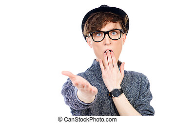 reaction - Positive young man wearing hat and spectacles....