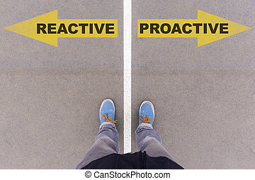 Reactive vs Proactive text on yellow arrows on asphalt ground, feet and shoes on floor, personal perspective footsie concept