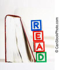 Read alphabet Block besides book