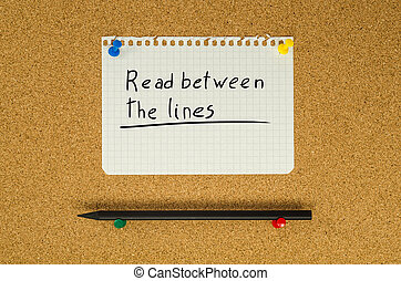 Read between the lines text note message pin on bulletin board
