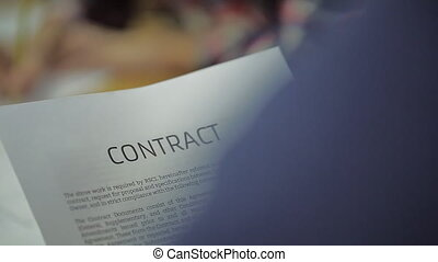 read Business Contract, Mutual Agreement, in blurring the background is the same Signing