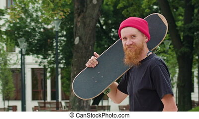 Readhead Hipster in Hat With a Skateboard