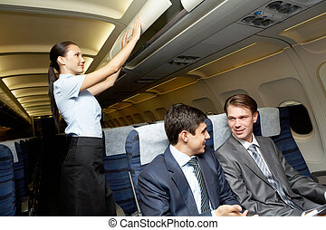 Readiness for flight - Photo of woman holding and giving...