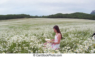 Reading a book in a field