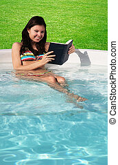 Reading a book in the pool