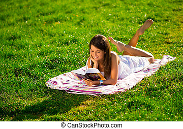 Reading a book in the spring sun