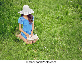 Reading a book on nature