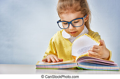 reading a book - small beautiful child reading a book