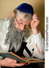 Reading a jewish book - Old jewish man with beard reading a...