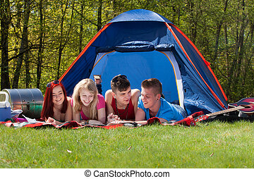Reading a map on our blanket - Young teenager group are...
