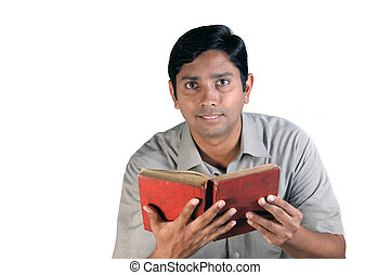 An handsome middle aged man reading an old book