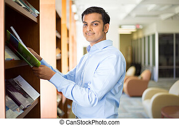 Reading and studying - Closeup portrait, young business man ...
