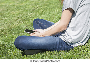 reading blank screen phone legged on grass
