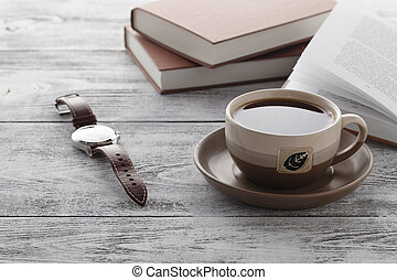 Reading book in time of breakfast with coffee